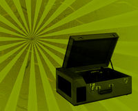 Retro Record Player. Vintage record player in case set on a sunburst distressed background Royalty Free Stock Photography
