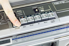 Retro recorder with open deck and finger on it Stock Photos