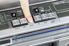Retro recorder with open deck and finger on it Royalty Free Stock Image