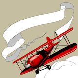 Retro red airplane with the ribbon banner in the sky royalty free illustration