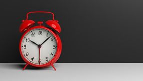 Retro red alarm clock on tabletop Stock Photography
