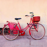 Retro red bicycle Stock Images