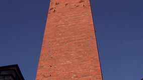 Retro red brick chimney and blue sky stock video