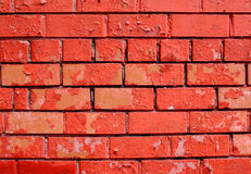Retro red brick wall bad pained as background Royalty Free Stock Photos