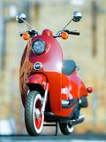 The retro red classic scooter motor on street of city. 3d stock photos