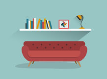 Retro red sofa and book shelf with lamp. Stock Photo
