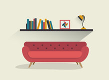 Retro red sofa and book shelf with lamp. Stock Images