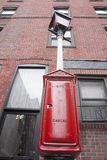 Retro red street cable box, Boston. BOSTON, USA - OCTOBER 14; Retro looking red city cable junction box and warning lamp in street on October 14, 2014 in Boston Stock Images