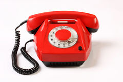 Retro red telephone on white background Royalty Free Stock Images