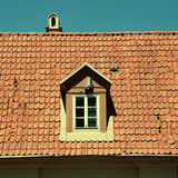 Retro red tile roof of old house Stock Photos