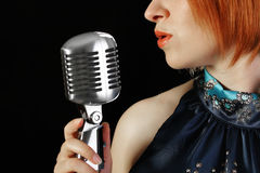 Retro redhead female singer Royalty Free Stock Photos