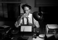 Retro reporter working late and smoking Stock Images