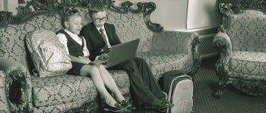 Retro revival image of school kids use laptop computer Stock Image