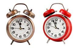 Retro ringklocka på `-klockan för nolla tolv, isolat Arkivfoton
