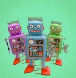 Retro robot confusi a tre colori Immagine Stock
