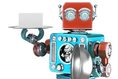Retro robot holding a tray with blank card. Isolated. Contains clipping path Royalty Free Stock Photography