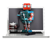 Retro Robot with laptop and vacuum cleaner. Isolated. Contains clipping path. Retro Robot with laptop and vacuum cleaner. Isolated over white. Contains clipping Royalty Free Stock Images