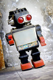 Retro robot posing Royalty Free Stock Image
