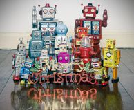 Retro robots with gifts on a old wooden floor. With reflection stock images
