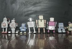 Retro robots at school looking at  a blackboard Stock Photography