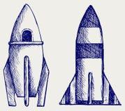 Retro rocket. Doodle style. Vector sketch Stock Photos
