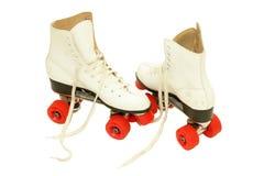 Retro roller skates. Retro woman roller skates isolated on white background Stock Photos
