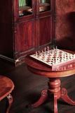 Retro room interior with chess table Royalty Free Stock Image