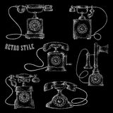 Retro rotary dial telephones chalk sketch icons Stock Image