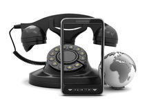 Retro rotary and modern cell phone Royalty Free Stock Images