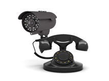 Retro rotary phone and security camera Royalty Free Stock Image