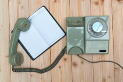 Retro rotary telephone with cable and white empty paper or noteb Stock Photography