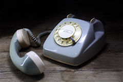 Retro rotary telephone with rotary dial and removed receiver on Stock Photography