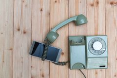Retro rotary telephone or vintage phone with cable and new cell Stock Photo