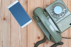 Retro rotary telephone or vintage phone with cable and new cell Stock Image