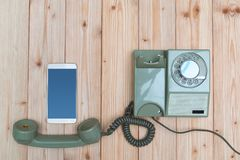 Retro rotary telephone or vintage phone with cable and new cell Royalty Free Stock Images