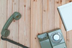 Retro rotary telephone with cable and white empty paper or noteb Stock Photo