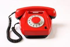 Retro- rotes Telefon auf weißem Hintergrund Lizenzfreie Stockbilder