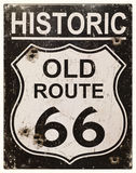 Retro Route 66 sign. Sepia effect retro sign for the historic old Route 66 in America. Faded, vintage style with bullet holes royalty free stock images