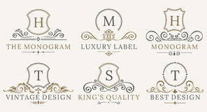 Retro Royal Vintage Shields Logotype set. Vector calligraphyc Luxury logo design elements. Business signs, logos Stock Image