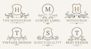 Retro Royal Vintage Shields Logotype set. Vector calligraphyc Luxury logo design elements. Business signs, logos Stock Photos