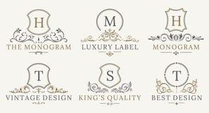 Retro Royal Vintage Shields Logotype set. Vector calligraphyc Luxury logo design elements. Business signs, logos Stock Image