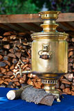 The retro russian  samovar with woods Stock Images