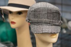 Retro 70s hats on mannequins. 2 different retro 70s hats on mannequins the front one is a black and white plaid royalty free stock photography