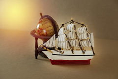 Retro sailing boat and globe model Royalty Free Stock Images
