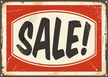 Retro sale sign on old damaged metal background Royalty Free Stock Image