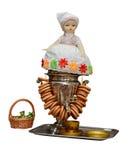 Retro samovar med en bagel och en retro docka på den Arkivbild