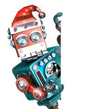 Retro Santa Robot looking out from behind the blank board. . Contains clipping path Royalty Free Stock Photography