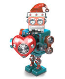 Retro Santa Robot with mechanical heart. . Contains clipping path Stock Photography