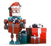 Retro- Santa Robot mit Geschenkboxen Weihnachtsniederlassung und -glocken , enthält Beschneidungspfad Lizenzfreie Stockbilder