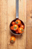 Retro saucepan full of tomatoes Royalty Free Stock Photos